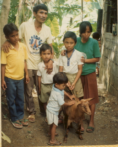 Boy and Family with Goat